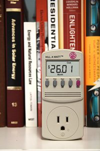 Kill-a-watt monitor in front of library books