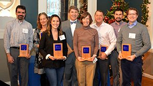 Award winners of the Leadership of Energy Efficiency Award standing with their plaques.