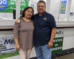 a man and woman looking at the camera