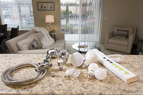 a collection of lightbulbs and faucets and power cords