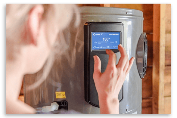 a woman inputing information into her water heater's touchscreen