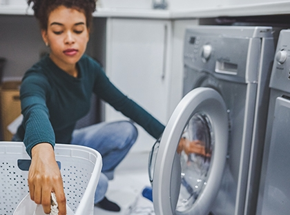 woman loading dryer