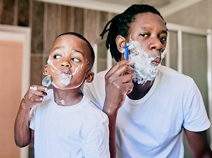 Dad and son shaving