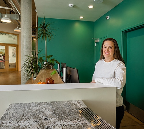 woman working at front desk of hotel